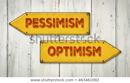 direction signs on a wooden wall   pessimism or optimism stock photo © zerbor