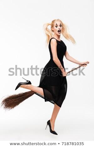 Güzel genç kadın siyah cadı halloween kostüm Stok fotoğraf © deandrobot