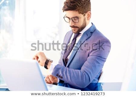 üzletember · néz · karóra · fiatal · férfi · megbeszélés - stock fotó © pixinoo