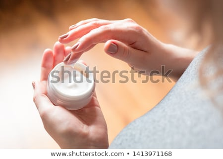 Applying face cream stock photo © pressmaster