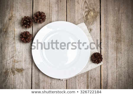 Old wooden plate  and autumn gifts on the wooden table top view Stock photo © Karpenkovdenis