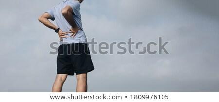 Koşucu yaralı plaj yandan görünüş çapraz çalışma Stok fotoğraf © deandrobot