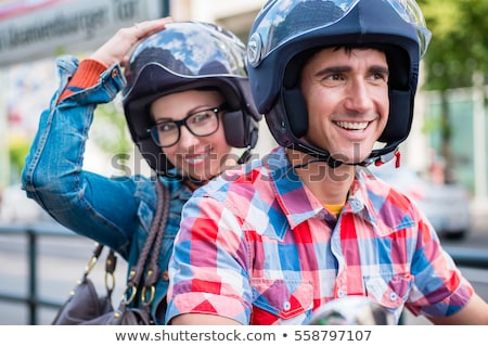 Girl with glasses sitting on pillion seat of scooter Stock photo © Kzenon