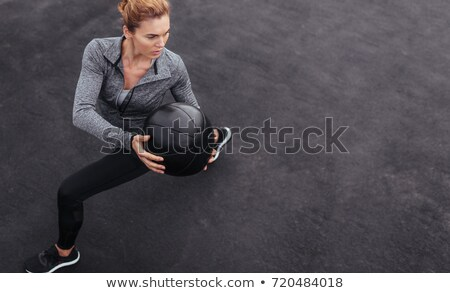 Fitness woman working out using training equipment in gym Stock photo © deandrobot