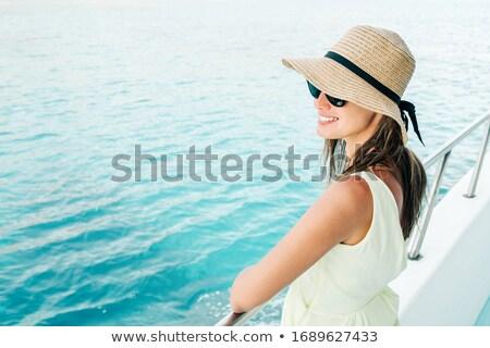 Beautiful brunette girl wearing hat on yacht Stock photo © deandrobot