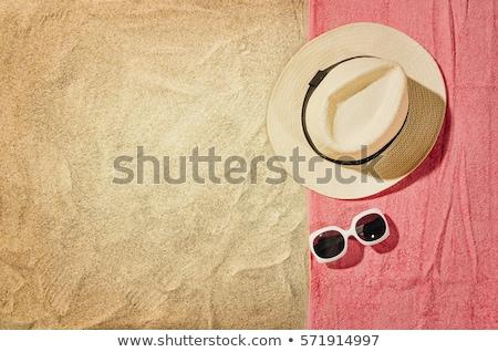 towel and sunbathing accessories on sandy beach stock photo © neirfy