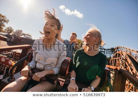 gülen · genç · kadın · lunapark · boş · insanlar · atlıkarınca - stok fotoğraf © tekso