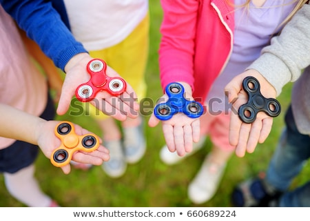 Girl playing with fidget spinner  Stock photo © wavebreak_media