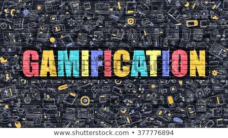 gamification on dark brick wall stock photo © tashatuvango