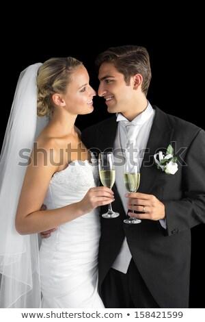 Young caucasian groom holding glass of champagne. Stock photo © RAStudio