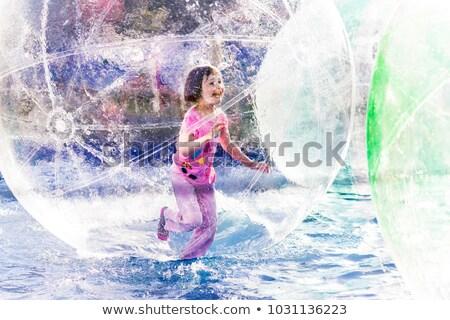 Meninas correr flutuante dois jovem Foto stock © FOTOYOU