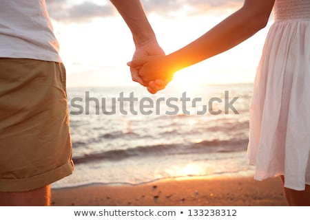 couple young in beach vacation sunrise stock photo © lunamarina