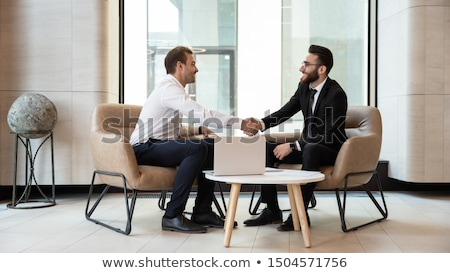 European businessmen in business suits handshaking Stock photo © studioworkstock