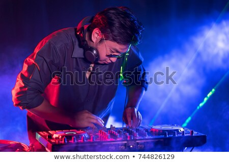 Pretty female DJ playing music Stock photo © wavebreak_media