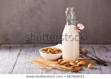 Kicsi üveg mandula tej közelkép frissítő Stock fotó © mpessaris