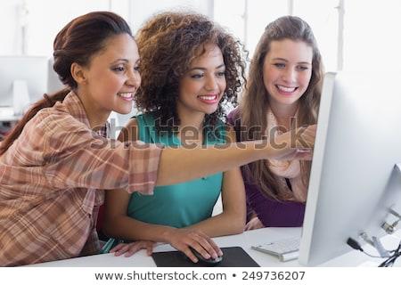 mosolyog · fiatal · nő · tanul · osztályterem · iskola · háttér - stock fotó © is2