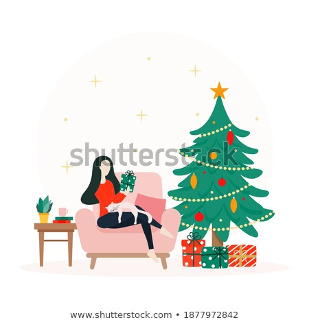 Woman next to a fir-tree, with present Stock photo © IS2