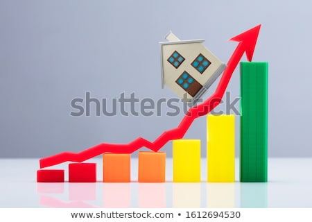 Row Of Increasing House Models On Desk Stock photo © AndreyPopov