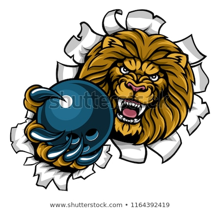 lion holding bowling ball breaking background stock photo © krisdog