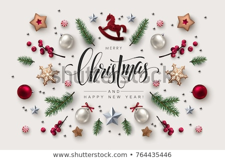 Christmas greeting card with calligraphic season wishes and composition of festive elements such as  Stock photo © ikopylov