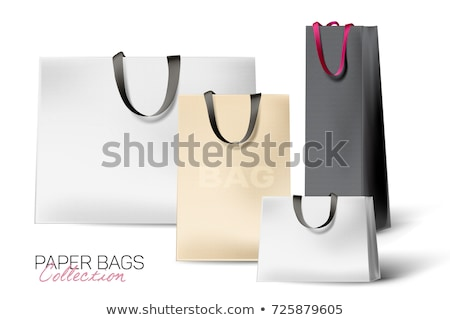 Realistic black Paper shopping bag with handles isolated on white background. Vector illustration stock photo © olehsvetiukha