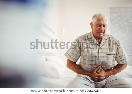 man suffering from stomach pain stock photo © andreypopov