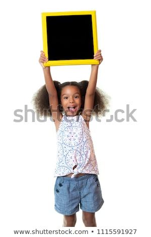 csinos · spanyol · lány · tart · tábla · vissza · az · iskolába - stock fotó © feverpitch