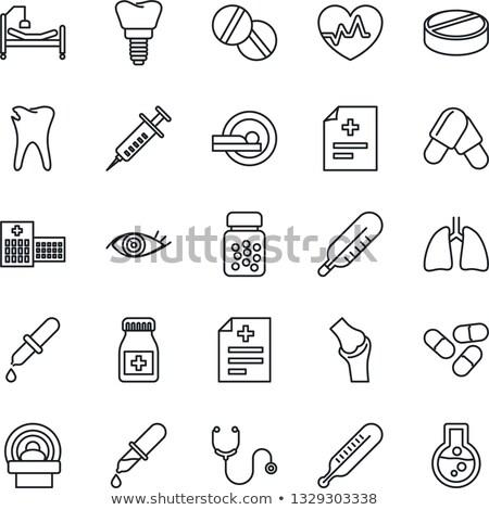 Hartslag teken pil capsule geïsoleerd witte Stockfoto © kyryloff