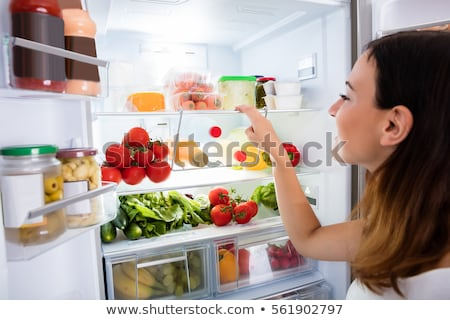 Nő keres étel hűtőszekrény hátsó nézet zavart Stock fotó © AndreyPopov