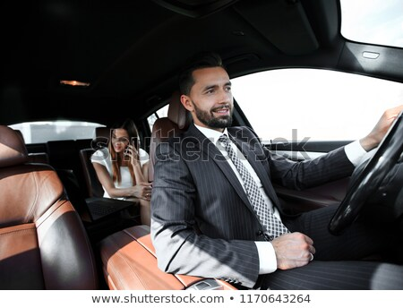 zakenvrouw · rijden · auto · mooie · brunette · geld - stockfoto © andreypopov