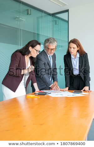 Business Strategy, Employer Pointing on Charts Stock photo © robuart
