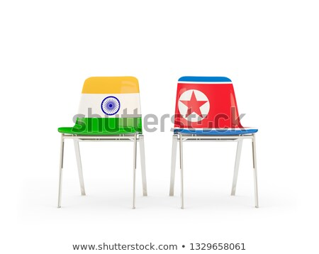 Two chairs with flags of India and north korea Stock photo © MikhailMishchenko