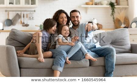 heureux · mère · fille · téléphone · ensemble · canapé - photo stock © dolgachov