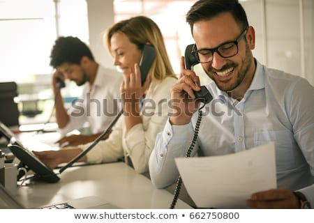 Businessman Talking on Phone Businesswoman Smiling Stock photo © robuart