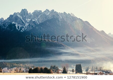 Stad bergen gedekt sneeuw zonsondergang Italië Stockfoto © frimufilms