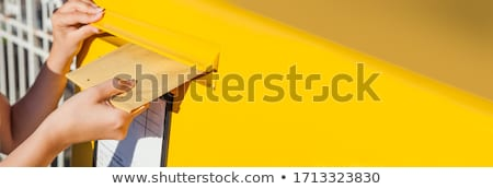 Person Inserting Envelopes In Mailbox Stock photo © AndreyPopov