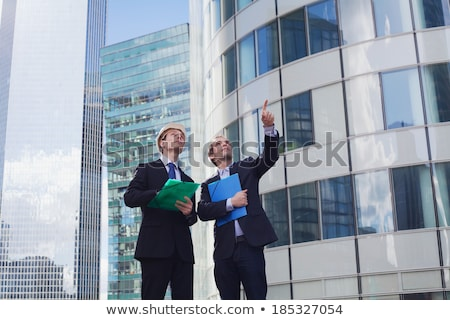 Stockfoto: Real Estate Concept Two Engineer And Architect Discussing Bluep