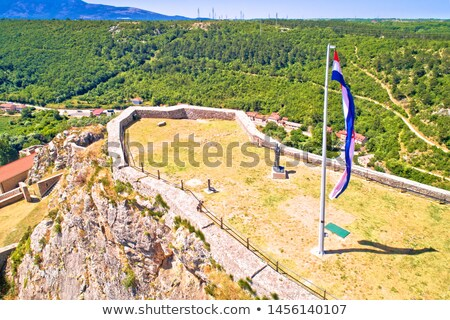 Knin fortress plateau nad large croatian flag aerial view, Stock photo © xbrchx