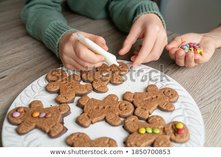 family decorating bakery by frosting on christmas Stock photo © dolgachov