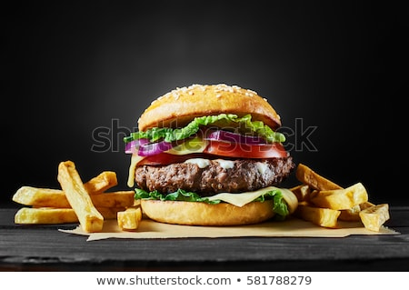 Stock photo: Craft beef burger  on wooden table isolated on black background.