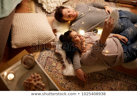 Couple taking selfie with mobile phone in living room at home Stock photo © wavebreak_media