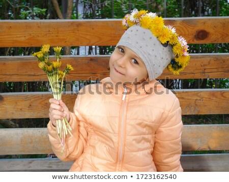 Uśmiechnięty dziewczyna szkoły wiek żółte kwiaty ręce Zdjęcia stock © ElenaBatkova