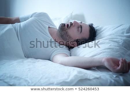 Homem adormecido cama casa fundo espaço Foto stock © AndreyPopov