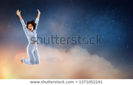 Feliz mulher saltando blue sky diversão pessoas Foto stock © dolgachov