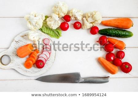 Szakács vág karfiol női szeletel darabok Stock fotó © Kzenon