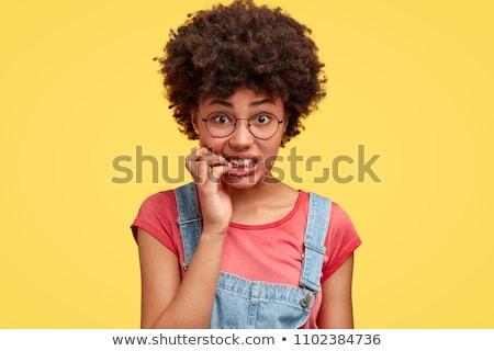 Fiatal afroamerikai nő érzés nyugtalan harap körmök Stock fotó © diego_cervo