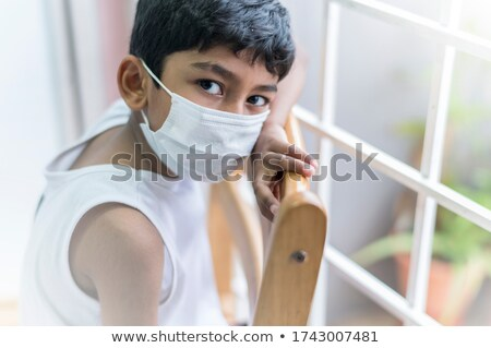 man wearing a surgical mask in the window Stock photo © nito