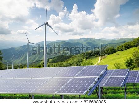 Szélturbinák alternatív megújuló energia naplemente égbolt megújuló Stock fotó © artjazz