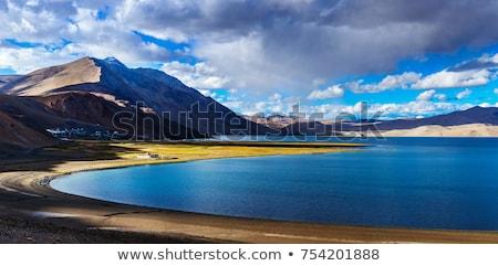Himalaia lago pôr do sol montanha céu nuvens Foto stock © dmitry_rukhlenko