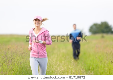 jogging sportive young couple running meadow field stock photo © candyboxphoto